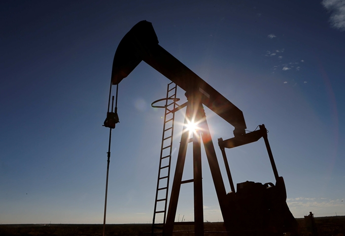 Crude oil prices extend rally as output cuts begin