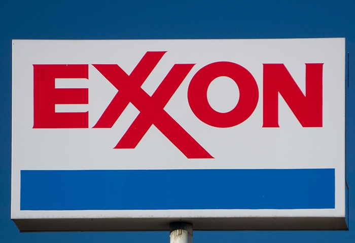 Exxon reports a historic loss while Chevron deepens cuts